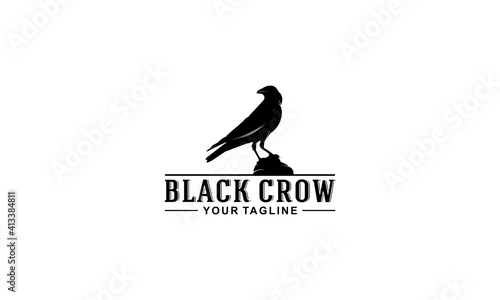 Fotografija black crow logo with illustration of a crow on a rock observing something