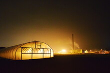 Illuminated Greenhouse Tent Against Sky At Night
