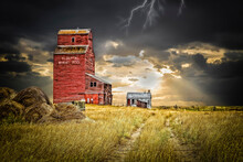 Old Abandoned Elevator Under A Dark Stormy Sky With Lightening