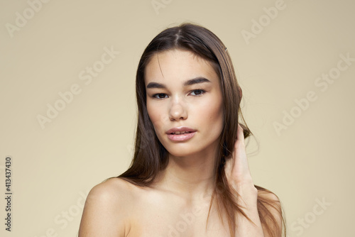 Fototapety, obrazy: Brunette with bare shoulders close-up long hair beige background clean skin