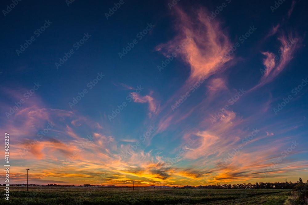 Fototapeta Scenic View Of Field Against Sky At Sunset