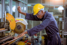 Factory Engineer Wearing Safety Uniform Control Operating Lathe Grinding Machine Working In Industry Factory.