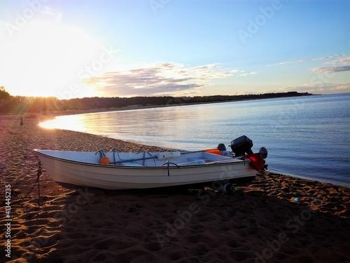 Obraz na plátně Motorboat On Shore At Beach Against Sky During Sunset