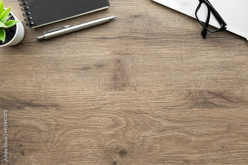 Fotografie, Obraz Wood office desk table with latop computer, notebook and pen
