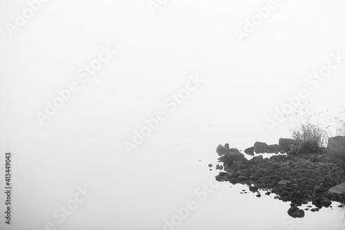 Fototapeta Fog in the lake. Morning nature water white fog.