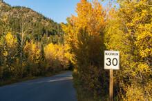 Maximum 30 Km Speed Limit Sign In Vermilion Lakes Road In Autumn Foliage Season Sunny Day. Banff Legacy Trail, Banff National Park, Canadian Rockies, Alberta, Canada.