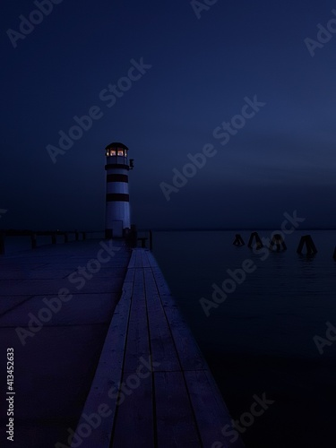 Canvas Print Lighthouse By Sea Against Sky At Dusk