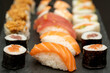 Japanese sushi food. Maki ands rolls with tuna, salmon, shrimp, crab and avocado. Close up and top view of assorted sushi.