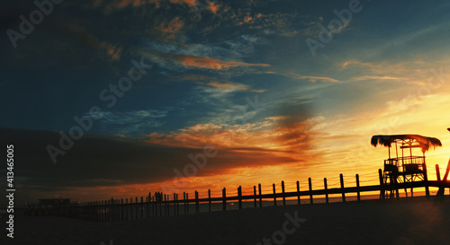 Fotografie, Obraz Silhouette Lifeguard Hut On Beach Against Sky During Sunset