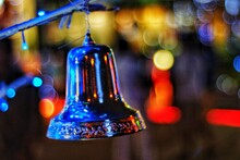 Close-up Of Bell Hanging During Christmas Celebration At Night