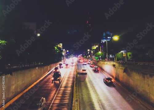 Fotografie, Obraz Vehicles On Road In City At Night