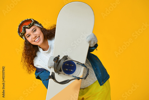 Female snowboarder on color background Wallpaper Mural