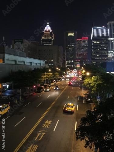 Fototapeta Traffic On City Street And Buildings At Night obraz