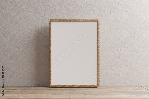 Canvas Print Empty wooden frame with space for inscription against a white wall