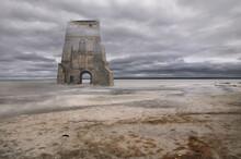 Old Ruin On Beach By Sea Against Sky