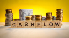 Cashflow Wording With Coins And Money In Background. Business Concept. Accounting Concept.