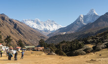 Tourists In The Mountains, Tengboche Village In Nepal On The Way To Everest Base Camp, Trekking And Travelling Concept, Active Travel, Hiking And Trekking In The Himalayas