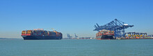 Two  Large Containers Ship One Leaving The Orwell Estuary At Felixstowe One Being Loaded.