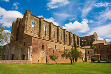 A Side View Of The Roofless San Galgano Abbey In Siena Province, Tuscany, Showing Arch Or Radius Windows At The Top. The Gothic 13th-century Abbey Was Founded As A Cistercian Monastery