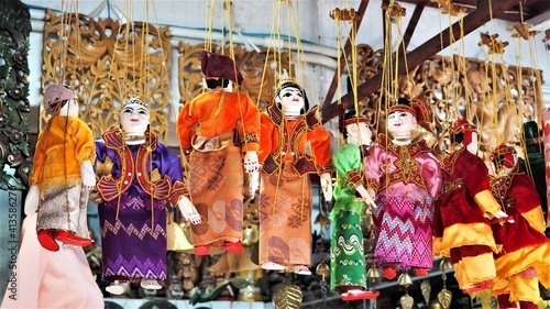 Obraz na plátně Low Angle View Of Puppets Hanging For Sale In Store