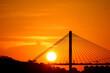 Leinwandbild Motiv Silhouette Suspension Bridge Against Sky During Sunset