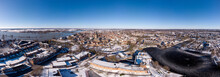 Super Wide Zutphen Aerial Panorama Winter Cityscape With Snow On The Dutch Hanseatic Medieval Town With River IJssel In The Back And Ice Skating On The Pond In The Foreground