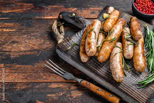 Grilling bavarian sausages on a cutting board Fotobehang