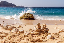 Summer Landscape, Waves With Brakes Break On A Stone, A Cairn Of Stones In The Sand, Kaputas Beach, Turkey