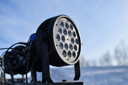 Tela Close up of light and music projector equipment installed outdoors in winter