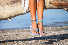 Woman Legs In  Summer Flat Slippers Flip Flops Outdoor On Beach Front View Summer Sunny Day