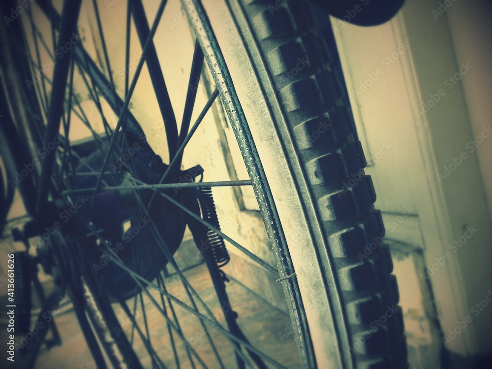 Fototapeta Cropped Tire Of Bicycle Parked By Wall