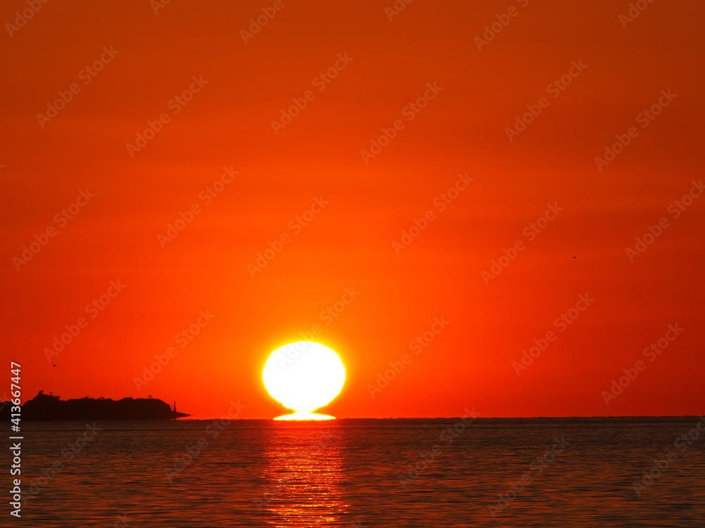 Fototapeta Scenic View Of Sea Against Orange Sky