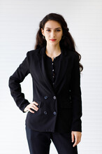 Studio Shot Portrait Of A Smart And Confident Middle-aged Caucasian Businesswoman In Formal Clothes With Arm Akimbo Looking At The Camera Isolated With White Background. Concept Of Successful CEO