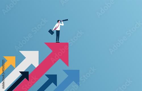 Fotografia Successful businessman standing on the arrow vector illustration.