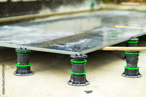 Obraz na plátně Slope-adjustable pedestal used for paver, bearer support instead of bedding sand brick, concrete, metal piers