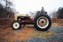Old Tractor Parked On Field Against Sky