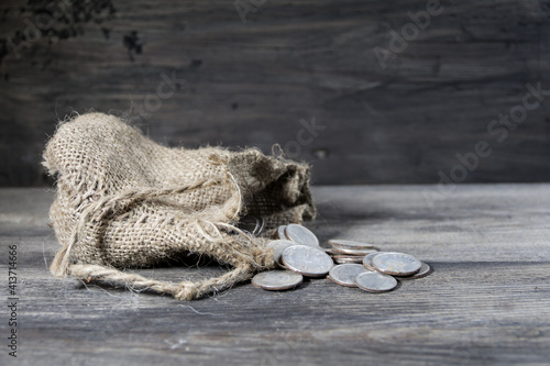 sack with the thirty silver coins biblical symbol of the betrayal of judas Fototapet