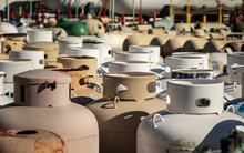 A Large Group Of Propane Tanks In An Industrial Yard