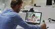 Caucasian male teacher using laptop on video call with schoolgirl