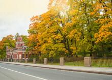 Autumn Park In Tsarskoye Selo. The Road Along The Autumn Trees And The Hermitage Kitchen, Catherine Park, Tsarskoe Selo, Saint Petersburg, Russia