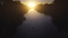 High Angle View Of Father And Son Boating In Lake During Sunset