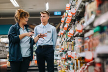 Supermarket Manager Giving Training To A Trainee