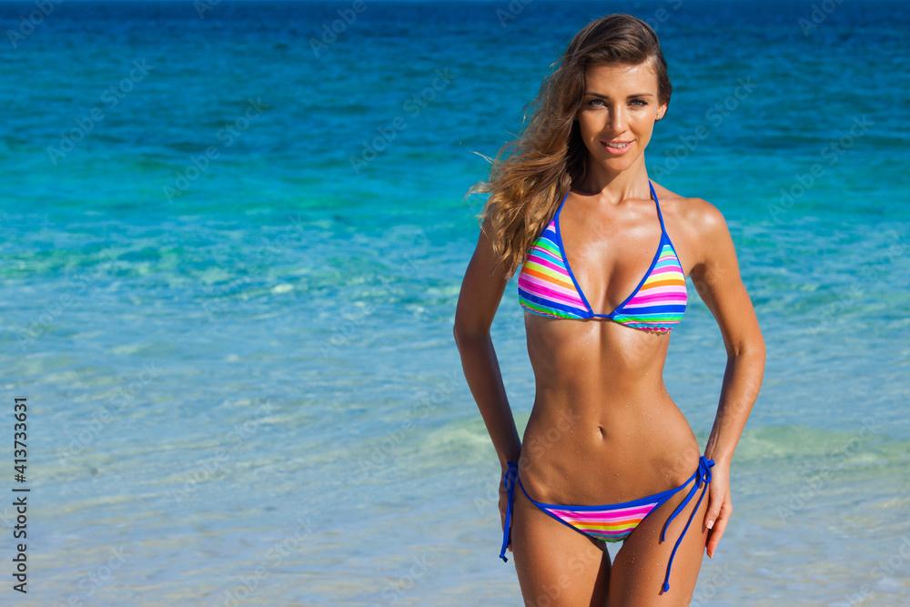Fototapeta Happy woman on beach