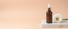 Cosmetic Bottles With Dark Glass Pipette On Podium Of Marble Boxes. Natural Serum Concept. Beige Background