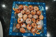 High Angle View Of Hanukkah Sufganiyot Sweet Desserts On Table