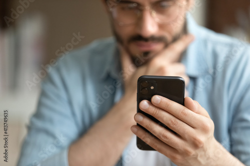 Crop close up of man hold modern smartphone gadget look at screen text or message online Fototapete