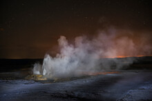 Majestic View Of Steam Emitting From Geyser At Yellowstone National Park Against Star Field