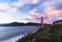 Golden Gate Bridge Over Sea Against Cloudy Sky At Yosemite National Park During Sunset