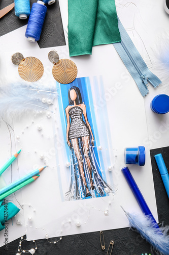 Fototapeta Fashion designer workplace with sketches on dark background obraz