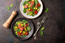 Healthy Salad With Fresh Baby Spinach, Cherry Tomatoes, Avocado And Salmon Fish